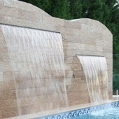 tiled water fountain above pool